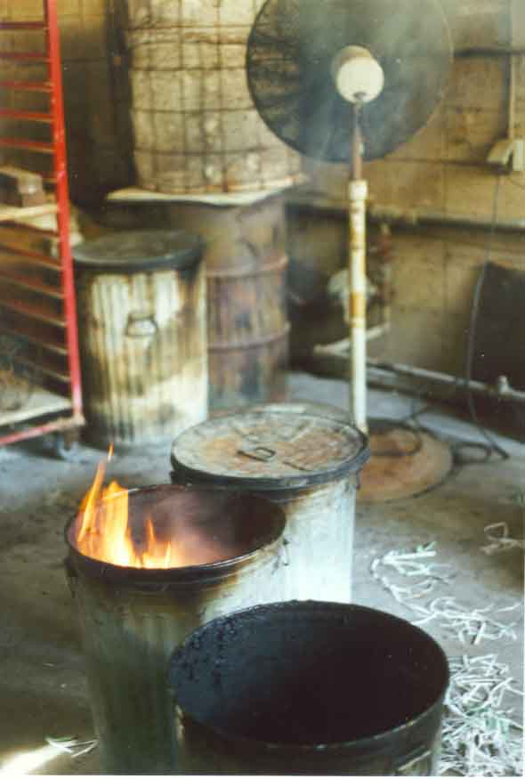 A fan is used to help eliminate the smoke resulting from the pottery being placed in the reduction chambers